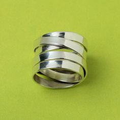 GIVEAWAY for US & Canada residents! As thanks to my Pinterest fans, everyday this week I will be giving away 1 item sponsored by Sneekpeeq! Today's giveaway is this sterling silver coil ring by Paz Collective valued at 75 dollars! TO ENTER: Re-pin this image and by tomorrow afternoon, May 18th, I will pick one winner and will announce it in a comment on this pin along with instructions on how the winner can claim their prize. Giveaway ends tonight, May 17th, at midnight PST time!