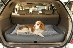 """Travel / SUV Bed in Grey. The small size fits perfectly in a small to midsized SUV while the large fits great in a mid to full size SUV. The bottom of the bed has a """"stay put"""" non-slip fabric to keep the bed in place...and it's machine washable."""