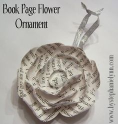 Recycled Book Page Flower Ornament  {Ornament Number Three}  Materials Needed:  Clean Metal Jar Lid  Book Pages or Scrapbooking Paper  Ribbon  Your Choice of Embellishments {Glitter/Clear Glass Vase Gem}