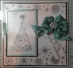 Using sTamps by Chloe sparkling tree and beaded snowflake border.