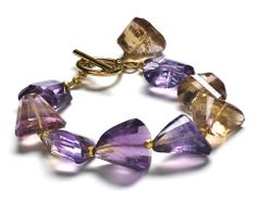 Amethyst is a great gemstone match for radiant orchid! Find this ametrine bracelet by Naomi Fujimoto in the March 2014 issue of Bead Style magazine. beadstylemag.com