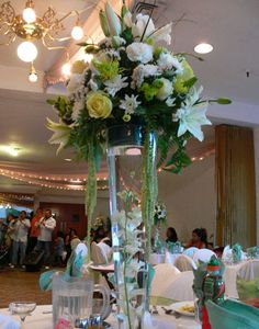Tall white, yellow & light green centerpiece   Found on Weddingbee.com Share your inspiration today!