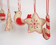 red and white felt Christmas Ornaments. these are so cute. diy?
