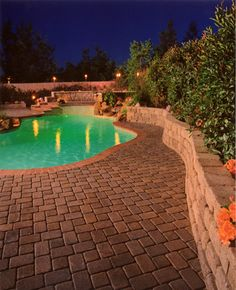 Redo your pool deck area with gorgeous, long-lasting pavers.