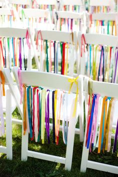 Chair decor for a graduation party. Great way to dress up those rental chairs. Choose school colors!