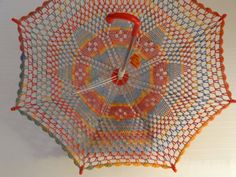 Crochetoville sells dozens of #crochet umbrellas in various sizes on Etsy. I like this diamond rainbow kids' crochet umbrella.