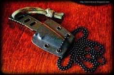 Two-strand Footrope Knot, #783 in ABoK, paracord lanyard/fob tied on a small neck knife for added grip/retention.