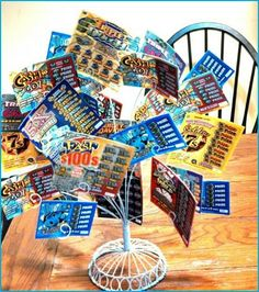 Repurpose a wire photo holder to display lottery tickets! A nice twist to the typical basket or bouquet idea. card display, fundrais basket, gift card, fundraising basket ideas, fundraiser baskets, basket raffl, fundraising baskets, fundrais idea, fundraiser gift basket ideas