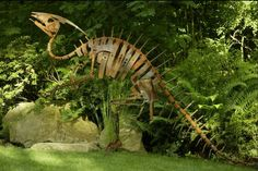 'Parosaurolophus', in Mike Urban's 'Cretaceous Garden'. Mike Urban welds dinosaur sculptures from bits of metal. Reclaimed scraps from tractors, shovels and other implements give the dinosaurs even more charm. This Parosaur is about fifteen feet long and stands at nearly seven feet. The signature nasal cavity on the head is made from an over-sized pick-axe.