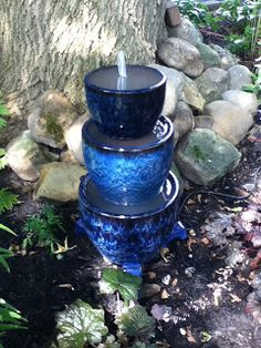 DIY instructions for making outdoor water fountain using flower pots