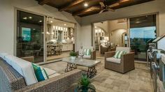 Outdoor living is elevated at Bridges at Las Colinas with an expansive #patio area complete with an #outside #kitchen, high #beam #ceiling and large sliding #windows that connect your #home with the gorgeous #outdoors. #patio #furniture #ideas