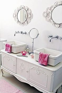 Turning dressers into vanities. I would do larger mirrors though. Maybe even mounted the faucets through one large mirror.  Place those above the toilet over each other for an accent but this accents their small size.