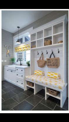 Put bench and storage where closet is now, put sink in current countertop