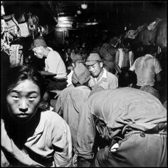 JAPAN. Hiroshima. September 8, 1945. Japanese soldiers and civilians crowd trains bound for Tokyo after the demobilization of the Japanese military.