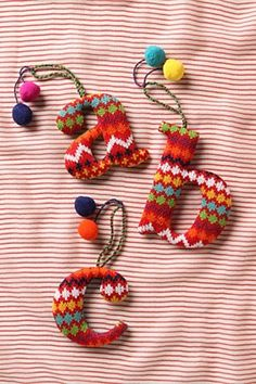 "anthropologie knitted letters- I'd like one of these on my flat door- a big ""O""!"