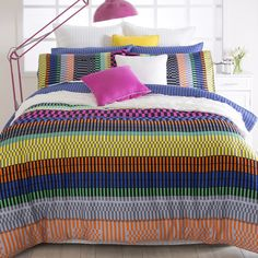 The Mirage Quilt Cover by Pillow Talk is a colorful geometric print quilt, which will definitely brighten up any room for spring or summer - #PillowTalkHome