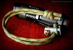 Paracord wrist lanyard with extended Matthew Walker knot and cord lock with leather knot work, on an inexpensive 3-mode zoomable cree LED flashlight, in which the Nitecore 14500 750mAh rechargeable battery cost more than the light...