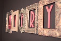 Love this idea! Put the letters of your baby's name in picture frames!
