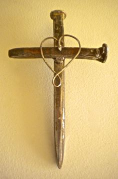 """Unfailing Love"" Cross, made of railroad spikes and rusted wire by artist Catherine Partain at crossesbycatherine.com"