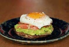 Add smoked salmon to a stack of avocado, fried egg, and a whole grain English muffin.