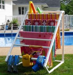 Pool Towel Drying Rack - I love the clean lines of this towel rack.  Pretty sure it looks like pvc pipes and that my kids would want to climb on it though.