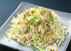 YUM! My mom used to make something like this.... I bag mixed coleslaw  I bag broccoli slaw  4 green onions (sliced)  4 tbl sesame seeds (toasted)  1 bag slivered almonds (toasted)  1 pkg top ramen noodles* (only)    Dressing  2 tbl sugar  1/2 tsp salt  1/2 tsp pepper  1/2 cup salad oil  3 tbl rice vinegar    Mix all ingredients together. Toss with the dressing just before serving.