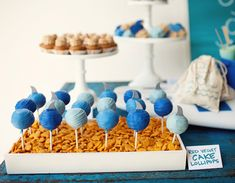 SO Cool! Cake pops in goldfish pool... love how colorful and inexpensive this idea is