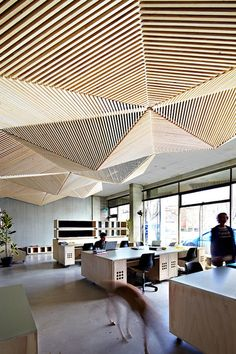 This office in Melbourne is made interesting and unique through its innovative ceiling. Brought to you by Shople office spaces, workplace design, office designs, studio office, the office, ceiling design, ceiling detail, wood ceilings, furniture placement