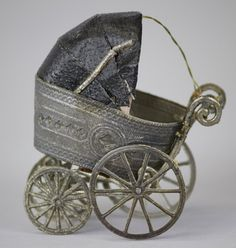 VICTORIAN BABY COACH CHRISTMAS ORNAMENT ~ German Dresden pram w/silver spoke wheels, black hood w/pink crepe paper curtain.