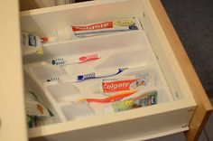Use a silverware drawer organizer for toothpaste & toothbrushes!!!  Why didn't I think of this??