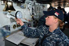 PACIFIC OCEAN (Sept. 5,  2013) Boatswain's Mate 3rd Class Kaitlyn Hunter, from Flower Mound, Texas, strikes the ship's bell aboard the aircraft carrier USS Ronald Reagan (CVN 76).