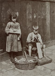 Two children living in poverty in Spitalfields, a district of London's East End (1912) — photo by Horace Warner