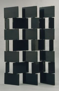 """Screen  Eileen Gray (British, born Ireland. 1879-1976)    1922. Lacquered wood and metal rods, 74 1/2 x 53 1/2 x 3/4"""" (189.2 x 135.9 x 1.9 cm). Manufactured by Eileen Gray Workshop, Paris, France."""