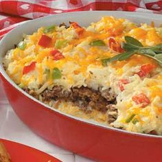 Sausage Hash Brown Bake ~ Pork sausage is sandwiched between layers of hash browns flavored with cream of chicken soup and French onion dip. Cheddar cheese tops the all-in-one breakfast or brunch casserole.