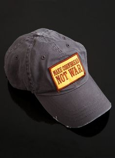saltairandfarm:    Sporting the unofficial motto of the Southern Foodways Alliance, the Make Cornbread Not War cap is distressed by hand in Alabama and each patch is sewn on by hand. A portion of the proceeds from the sale of these caps goes to support the Southern Foodways Alliance. (via Make Cornbread Cap - Faded Black)  I must have one of these now!!!!