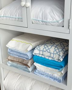 Great way to store sheet sets. Put the fitted and flat sheets inside of one of the matching pillow cases. How easy is this? Why didn't I think of it?
