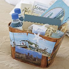 The welcome baskets for out-of-town guests featured saltwater taffy, an ocean-scented candle, soaps and more in a copper bucket adorned with vintage Jersey Shore postcards, by Michelle Rago, Ltd.