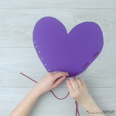 Primary and Kindergarten teachers will LOVE this how-to post and simple DIY heart pocket craft that is perfect for holding all the Valentine's Day treats and cards for children during your classroom celebration. #valentinesday #valentinesdayactivities #craftsforkids #kidcrafts #classroomactivities