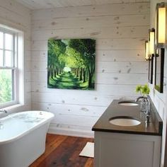 white wash knotty pine walls dark rough hewn hardwood flooring