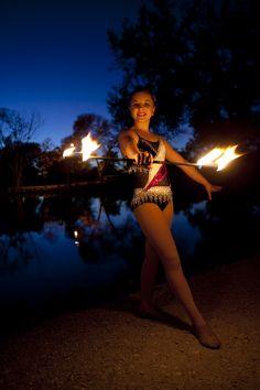 Fire baton twirling