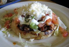 Sopes (or Sopitos).....muy bueno!!  Looking for an authentic recipe, as good as the restaurant's where I get them.