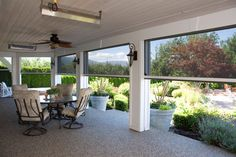 Retractable screens help bring the outside in - Kelowna BC - porch - vancouver - Phantom Screens