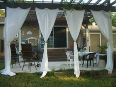 Hang curtains or fabric on pergola