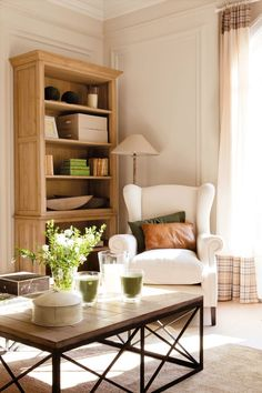 Modern Cottage Chic Living Room Moulding/Trim on walls, bookshelf, coffee table...