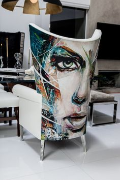 An artist rendering onto a piece of furniture. Not sure of its source or if it actually was hand painted, but we can create this actual chair style and create an image printed into the fabric.