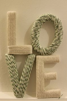 wooden letters wrappen in yarn