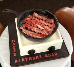 Bacon cake! My son would love this! but probably be upset when he found out the bacon wasn't real!