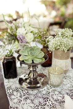 Succulents, babies breath, jute & lace, metal candle holders, medicine jars, mercury votives