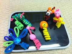 Finger Puppet craft with Pipe Cleaners, Pom Poms and Googly Eyes.