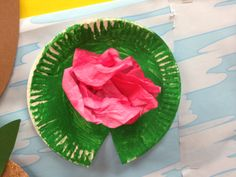 Lily pads made out of the little paper plates and a coffee filter that was colored with a pink marker then sprinkled with water.